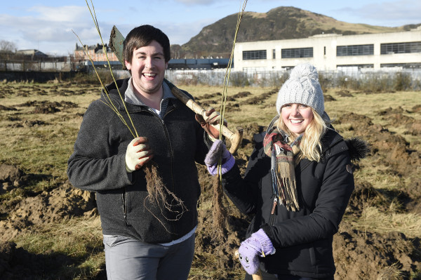 Pic Greg Macvean - 18/02/2016 - 07971 826 457 Greenfingered residents of Craigmillar come together to support a planting day held by the EDI Group and City of Edinburgh Council in partnership with Edinburgh and Lothians Greenspace Trust. Willow trees are planted in the area behind Craigmillar Library - Community Pages - Ryan Morton and Caitlin Dawson